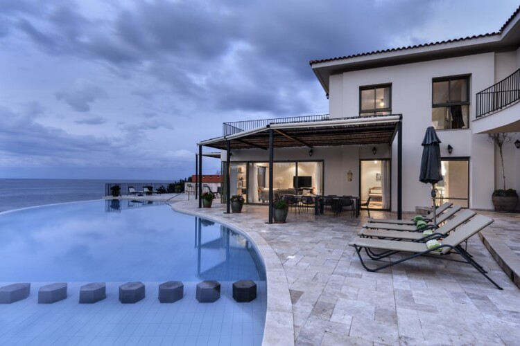 Seaside duplex villa with infinity pool and spacious green area